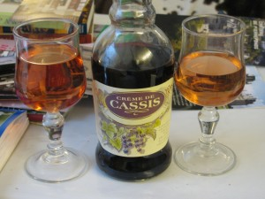 Kirs and a bottle of creme de cassis